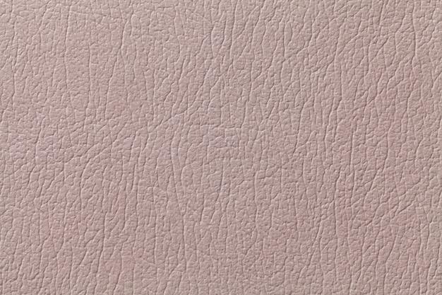 De beige achtergrond van de leertextuur met patroon, close-up