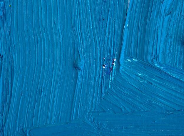 De blauwe abstracte achtergrond van de olieverfschilderijtextuur
