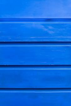 De blauwe houten achtergrond van de plankenmuur