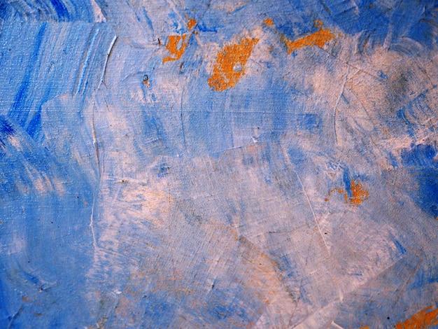 De blauwe slag van de olieverfschilderijborstel op canvas abstracte achtergrond en textuur