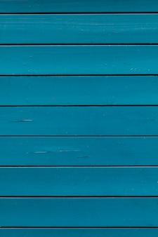 De blauwgroene textuur van de boom houten muur