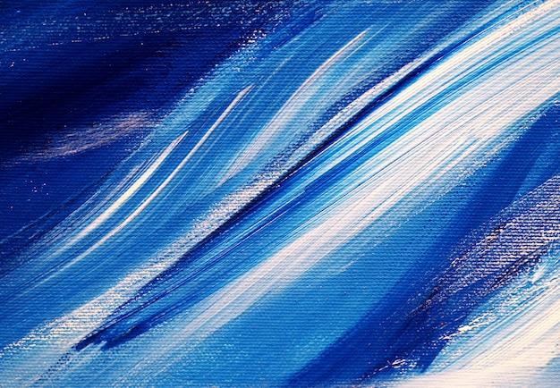 De borstel strijkt de witte blauwe abstracte achtergrond en de textuur van de kleurenolieverf.