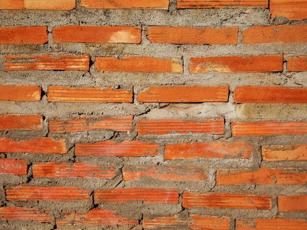 De bouwtextuur van de baksteenlaag van muur