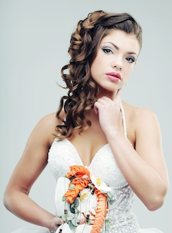 De bruid met een huwelijksboeket