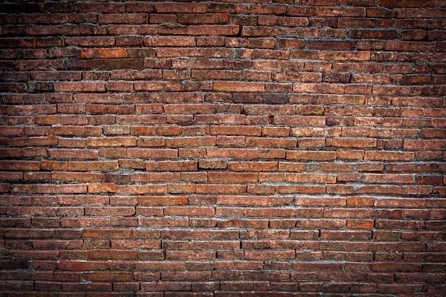 De bruine achtergrond van de bakstenen muurtextuur grunge met vignethoeken