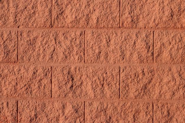 De bruine achtergrond van de bakstenen muurtextuur