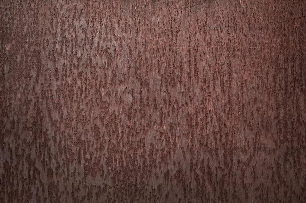 De bruine achtergrond van de ijzertextuur