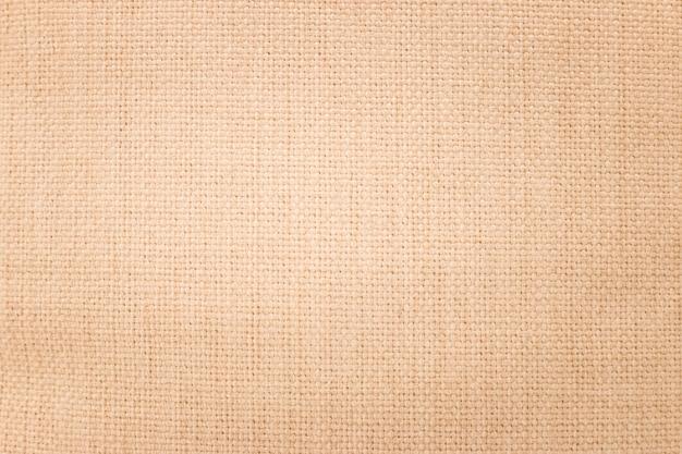 De bruine achtergrond van de jutetextuur. weef textielmateriaal of een lege doek.