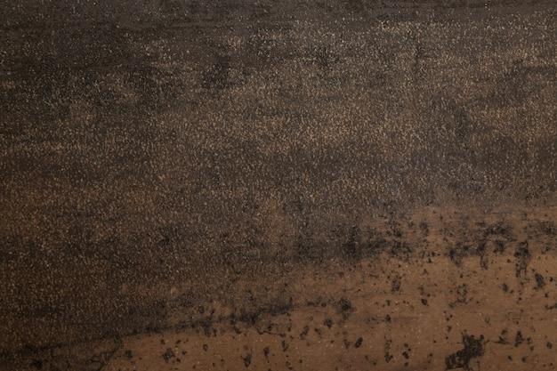 De bruine en grijze achtergrond van de steentextuur