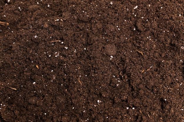 De bruine foto van de de textuur extreme close-up van het koffiepoeder