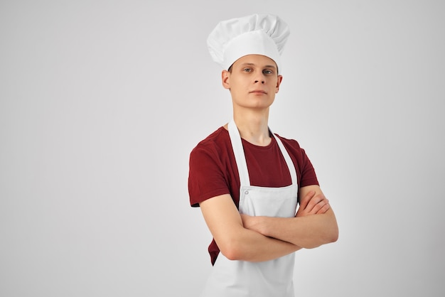 De chef-kok in het witte schort vouwde haar handen voor haar zelfverzekerde professionals. hoge kwaliteit foto