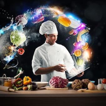 De chef-kok leest een voedselrecept van de tablet