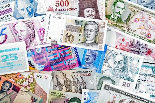 De collage en de achtergrond van wereldbankbiljetten