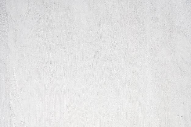 De concrete achtergrond van de muur witte geschilderde textuur