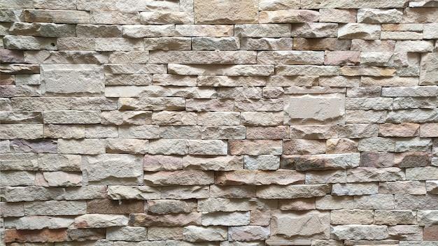 De de textuurachtergrond van het bakstenen muurpatroon.