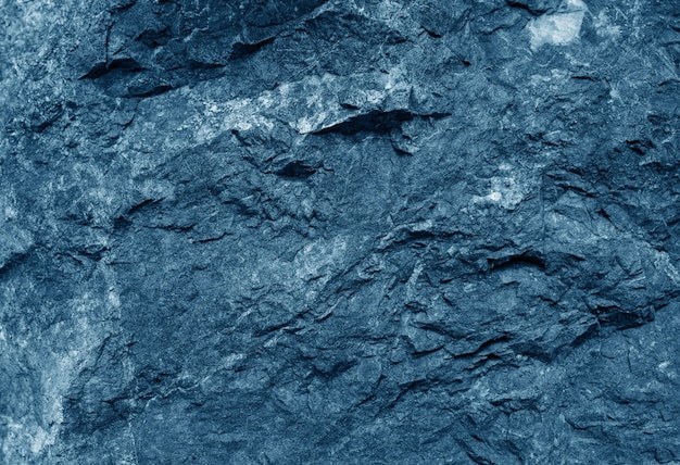 De donkerblauwe achtergrond van de cementtextuur