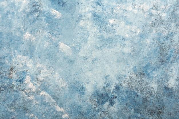 De donkerblauwe geweven achtergrond van de gipspleistermuur
