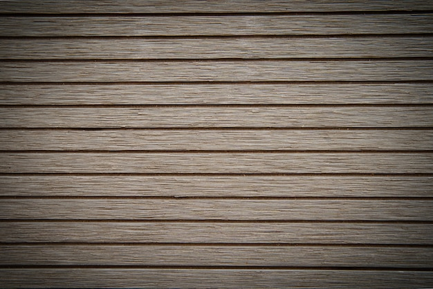 De donkerbruine houten achtergrond van de laminaatvloertextuur.