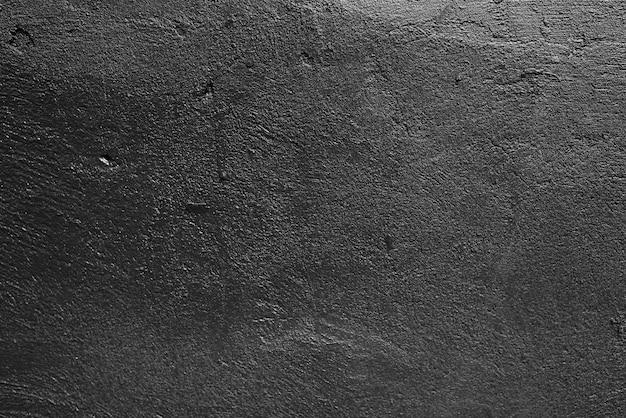 De donkere lege muur van het achtergrondtextuur concrete cement.