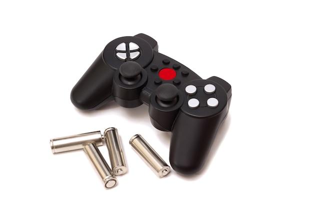 De draadloze gamepad van de gameconsole en de batterijen ervoor