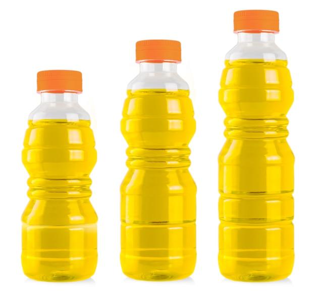 De drie flessen zonnebloemolie op wit wordt geïsoleerd