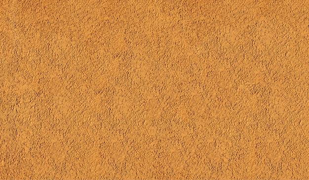 De echte achtergrond van de muurtextuur kleurde oranje grunge