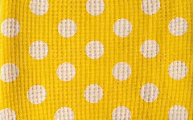 De echte stippen gele achtergrond. close-up shot van servet.