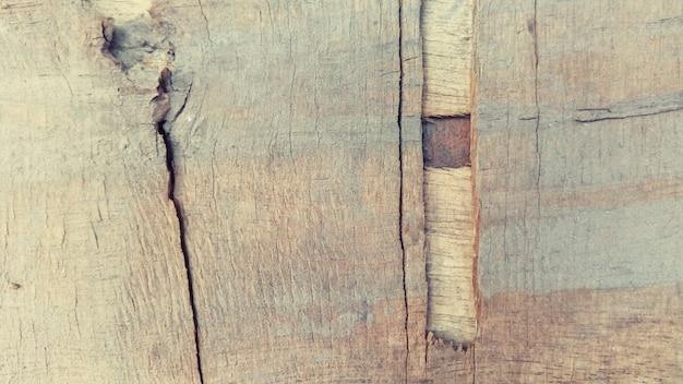 De gebarsten houten achtergrond van de textuuroppervlakte