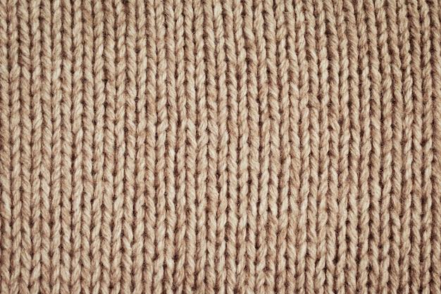 De gebreide textuur van de stoffenwol dicht omhoog
