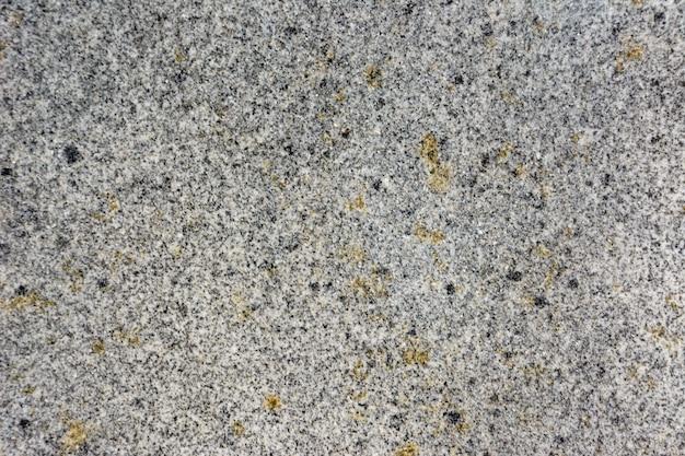 De gedetailleerde structuur van graniet in natuurlijk patroon voor achtergrond en ontwerp. de textuur van de steen.