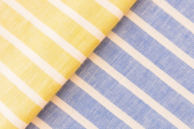 De gele en blauwe textuur van de linnestof