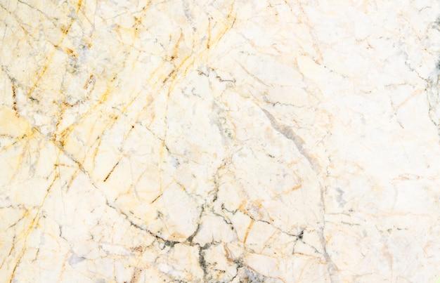 De gele marmeren achtergrond van de steentextuur