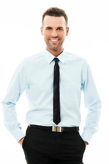 De gelukkige zakenman met van hem dient zakken in