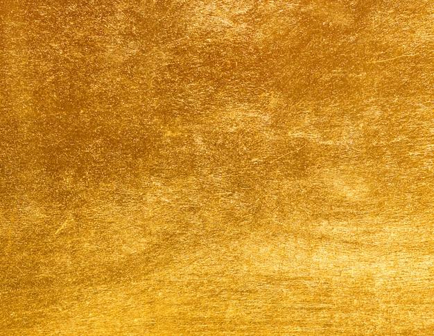 De glanzende textuur van de geel bladgoudfolie