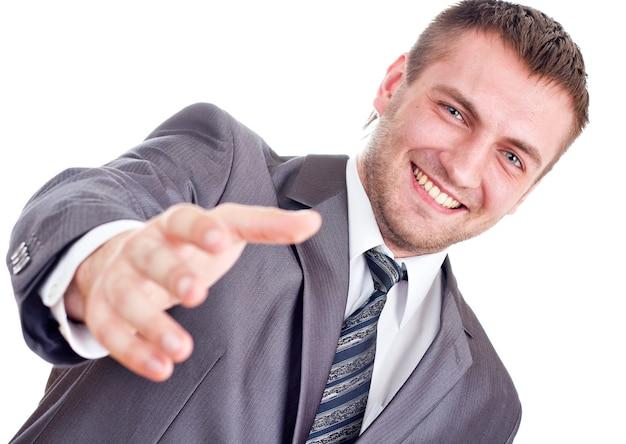 De glimlachende zakenman gaat handdruk