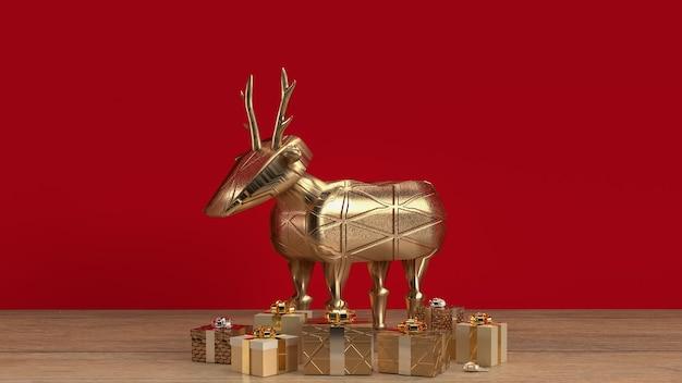 De gouden herten en geschenkdoos op houten tafel voor feesttijd