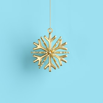 De gouden sneeuwvlok versiert de bal van kerstmis op blauw