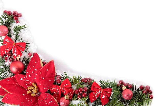 De grens van kerstmis met poinsettia