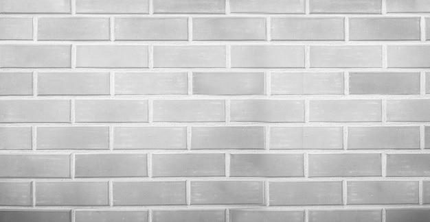 De grijze en witte achtergrond van de bakstenen muur lege textuur