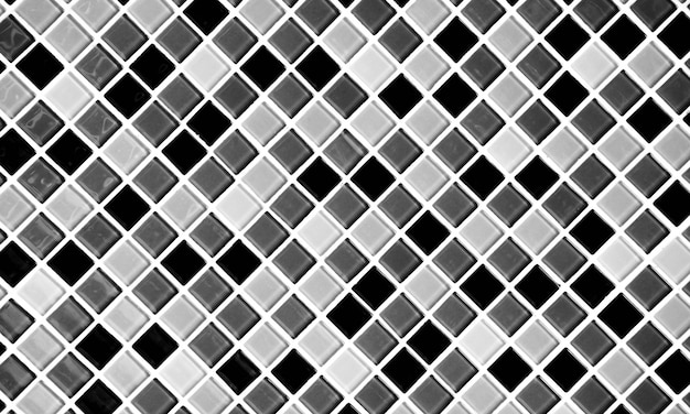 De grijze en zwarte textuur en de achtergrond van de mozaïekmuur