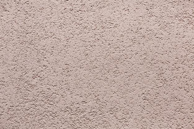 De grijze grungy achtergrond van de muurtextuur met exemplaarruimte