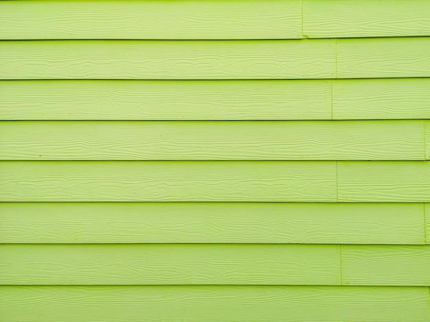 De groene achtergrond van het kleuren houten behang en de ruimte van het textuurexemplaar.