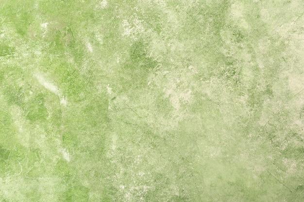 De groene geweven achtergrond van de gipspleistermuur