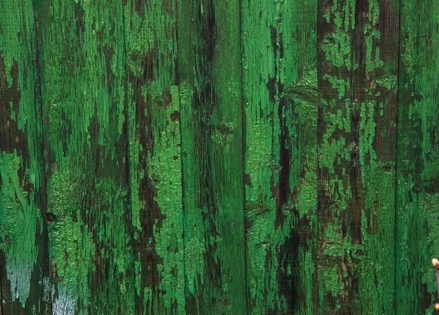 De groene munt schilderde houten raadstextuur en achtergrond.