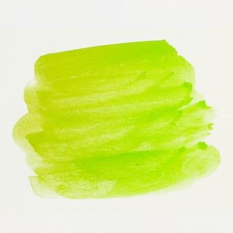 De groene penseelstreek van de waterverfvlek op wit canvas