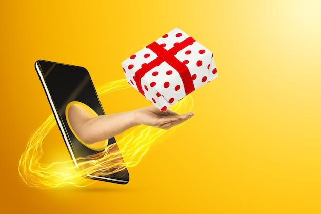 De hand die uit het smartphonescherm kruipt, houdt een geschenk vast