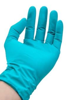 De hand medische handschoenen van de arts op witte achtergrond