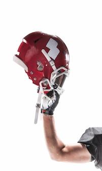 De hand van american football-speler met helm