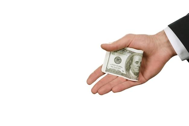De hand van de blanke zakenman met geld. amerikaanse dollars op witte achtergrond. oorsprong van misdaad. gemakkelijke manier om problemen op te lossen.