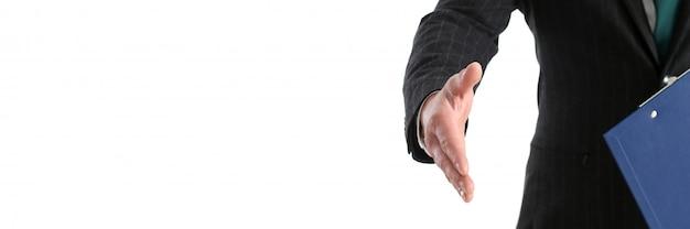 De hand van de zakenmanaanbieding om als hallo close-up te schudden